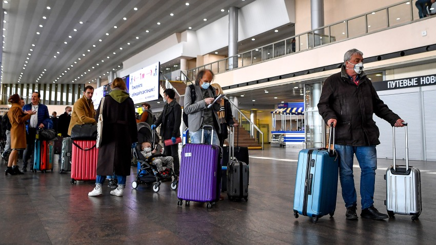 People gather at Moscow's Sheremetyevo airport terminal F