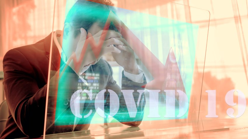 Concept of financial problems. Man holding his head while the markets plunge serious Covid-19 ,corona virus effect health investment