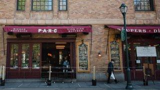 A restaurant serves take-out meals through their window in Philadelphia, Pennsylvania, U.S., on Wednesday, April 15, 2020.