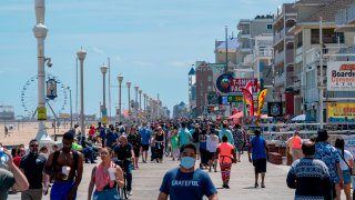 People enjoy the boardwalk during the Memorial Day holiday weekend amid the coronavirus pandemic on May 23, 2020 in Ocean City, Maryland