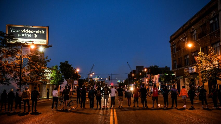 Protesters form a human chain near the 5th Police Precinct during a demonstration in Minneapolis on May 30, 2020.