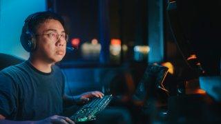 a mid adult man on Desktop PC game night