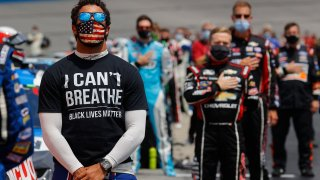 """Bubba Wallace, driver of the #43 McDonald's Chevrolet, wears a """"I Can't Breath - Black Lives Matter"""" T-shirt under his fire suit in solidarity with protesters around the world taking to the streets after the death of George Floyd"""
