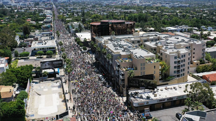 An aerial view as protesters walk on Sunset Boulevard during the All Black Lives Matter solidarity march, replacing the annual gay pride celebration, as protests continue in the wake of George Floyd's death on June 14, 2020 in Los Angeles, California.