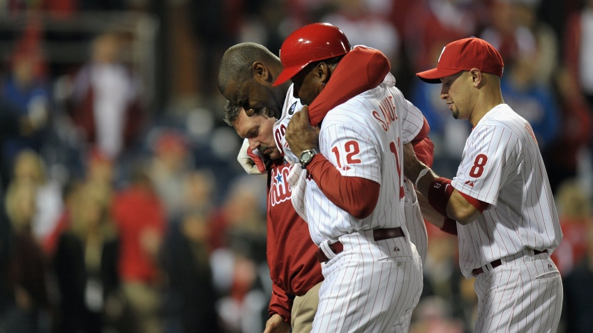Ryan Howard leaves the field in pain after losing in the NLCS in Oct., 2011