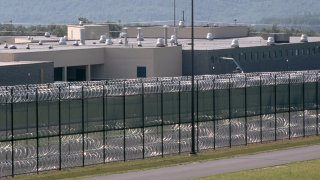 Barbed-wire fencing surrounds a prison in Pennsylvnia