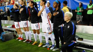 Megan Rapinoe kneels during the national anthem prior to the match between the United States and the Netherlands at Georgia Dome on Sept. 18, 2016, in Atlanta.