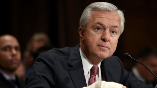 John Stumpf, then-chairman and CEO of Wells Fargo, testifies before the Senate Banking, Housing and Urban Affairs Committee on Sept. 20, 2016 in Washington.