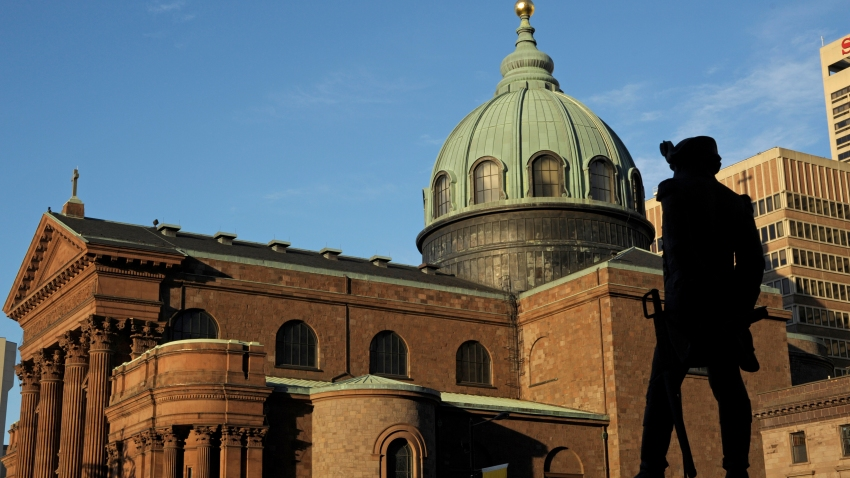 The Basilica of Saint Peter and Saint Paul, 1846-1864, in the foreground the statue of Tadeusz Kosciuszko, Philadelphia, Pennsylvania, United States of America