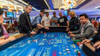 Patrons gamble inside the Hard Rock Hotel and Casino, previously the Trump Taj Mahal, on June 29, 2018 in Atlantic City, New Jersey.