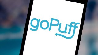 In this photo illustration the goPuff logo is seen displayed on a smartphone.