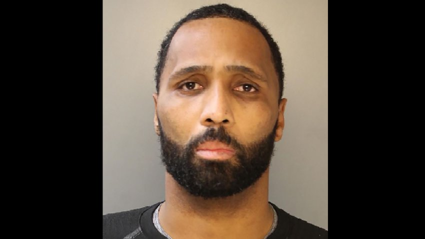 Philadelphia Police Sergeant Jason Reid looks at the camera in a mug shot.