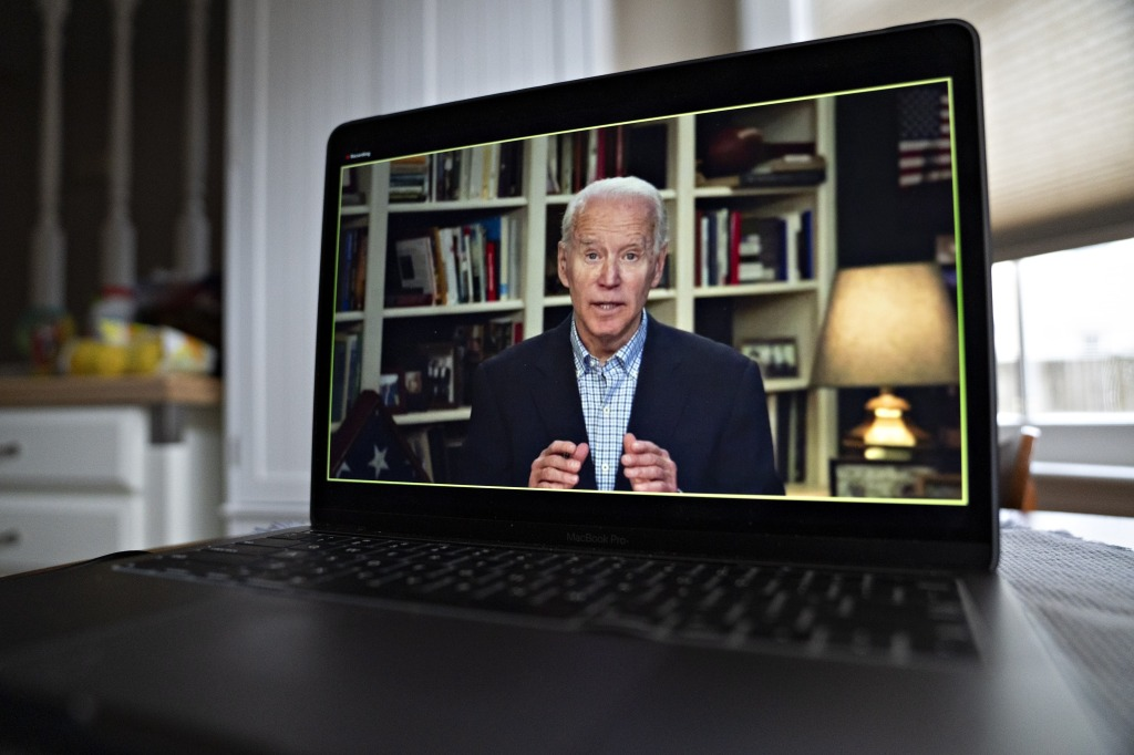Former Vice President Joe Biden, 2020 Democratic presidential candidate, speaks during a virtual press briefing on a laptop computer in this arranged photograph in Arlington, Virginia, U.S., on Wednesday, March 25, 2020.