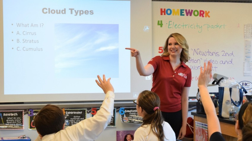 Krystal Klei doing a weather presentation for schoolchildren