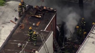 Firefighters battle flames