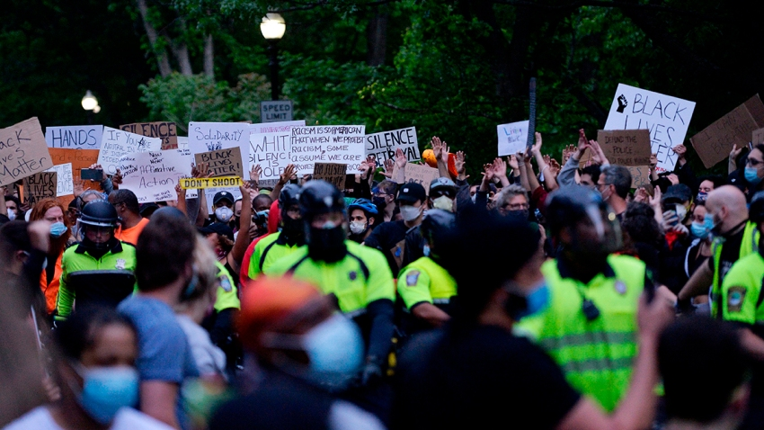 Protesters and police officers are seen at a peaceful demonstration in protest of the death of George Floyd and other black lives lost to police across the U.S. at Franklin Park in Boston, Massachusetts, June 2, 2020.