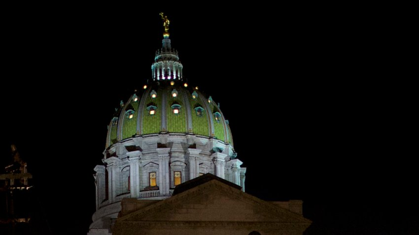 The Pennsylvania State Capitol dome rises in the night sky