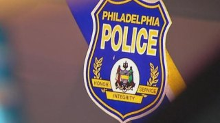 """A Philadelphia police department logo shows a badge with """"Philadelphia Police"""" written on it."""