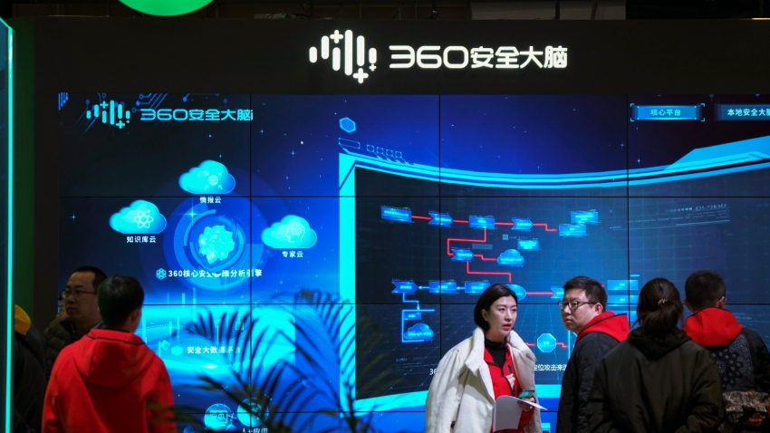 "In this Nov. 21, 2019, file photo, visitors tour the Chinese internet security firm Qihoo 360 showcasing its 5G digital security and protection system at the World 5G Convention in Beijing. One of China's biggest tech companies has criticized the Trump administration for ""politicizing business"" after it slapped export sanctions on 33 more Chinese enterprises and government entities."