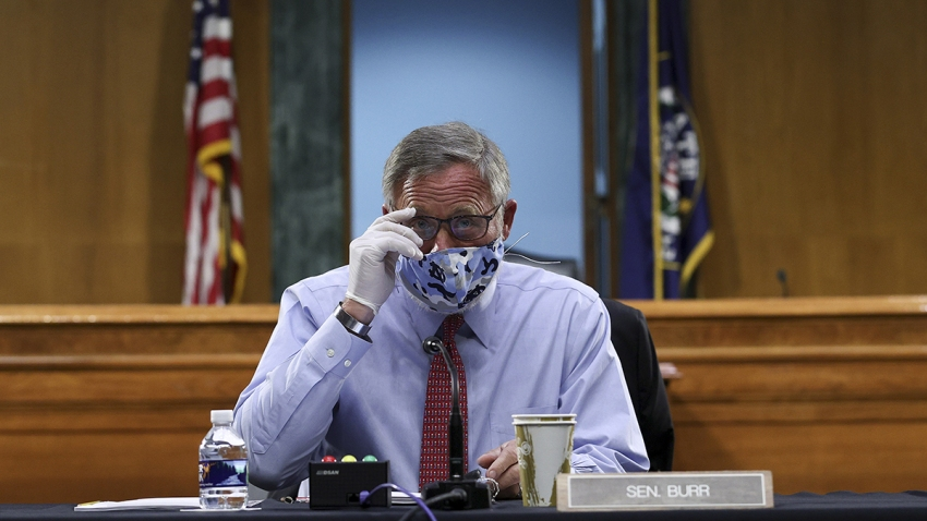 Sen. Richard Burr, R-N.C., wears a face mask and gloves during a Senate Health, Education, Labor, and Pensions Committee hearing, May 12, 2020, in Washington.