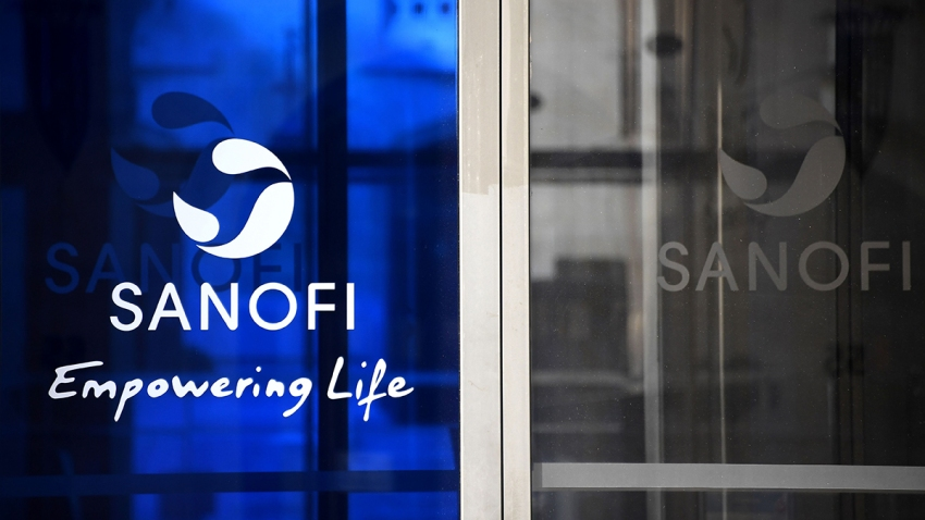 A photo taken on March 27, 2020, shows the Sanofi logo at the company headquarters in Paris.