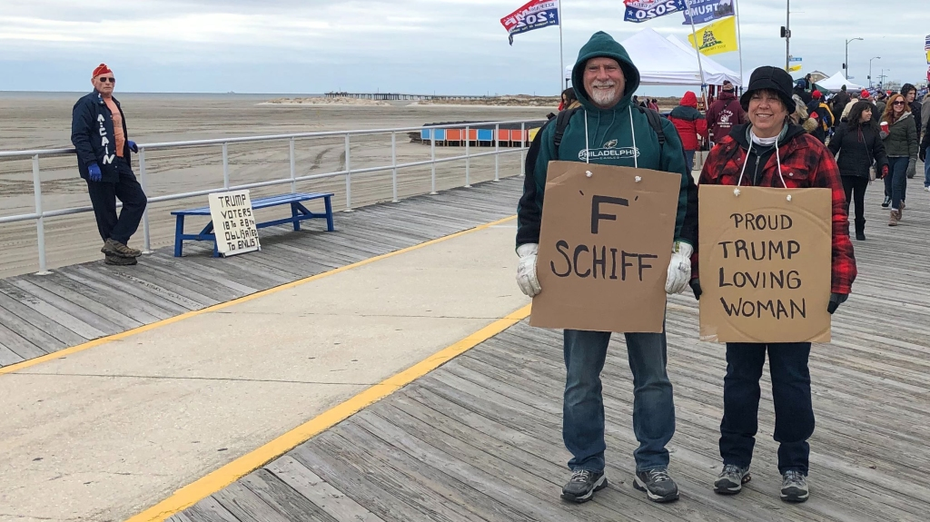 Man and woman stand on boardwalk