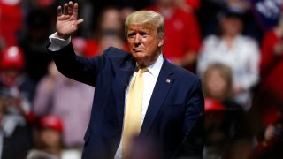 In this Feb. 20, 2020, file photo, President Donald Trump waves at a campaign rally in Colorado Springs, Colo.
