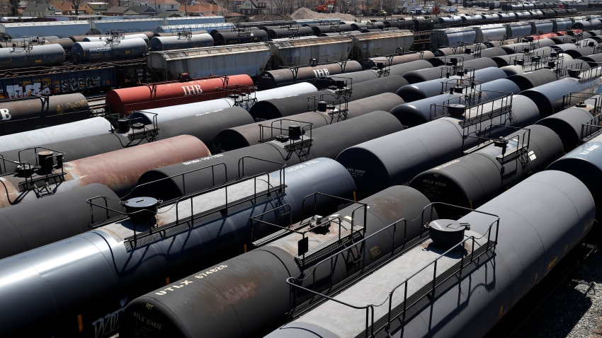 Oil tank train cars sit idle Tuesday, April 21, 2020, in East Chicago, Ind. The world is awash in oil, there's little demand for it and we're running out of places to put it.