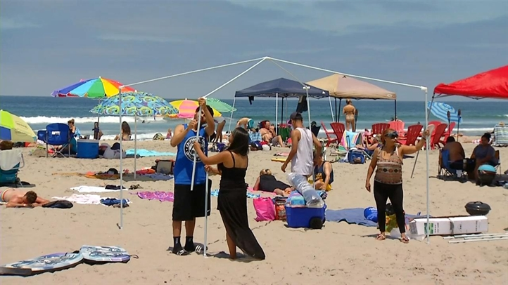 WEB_BEACH_AND_DOWNTOWN_070413_722x406_36096579911