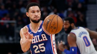 Philadelphia 76ers guard Ben Simmons passes during the first half of an NBA basketball game against the Detroit Pistons, Monday, Dec. 23, 2019, in Detroit.