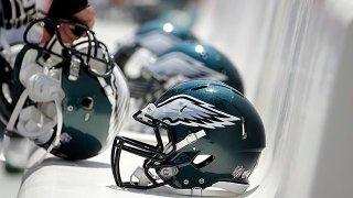 Philadelphia Eagles helmets on a bench