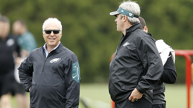 Philadelphia Eagles head coach Doug Pederson, right, speaks with team owner Jeffrey Lurie