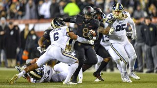 Army Black Knights quarterback Kelvin Hopkins Jr. (8) pushes his way past Navy Midshipmen safety Sean Williams and heads up the middle during the football game between the Army Black Knights and the Navy Midshipmen on December 08, 2018 at Lincoln Financial Field in Philadelphia PA