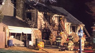 A house is burned after a deadly fire in Bucks County, Pennsylvania.