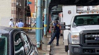 Philadelphia police investigate a body found in a suitcase