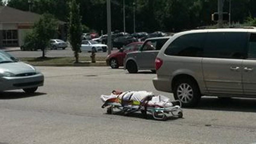 dead body falls out of coroner van crop2