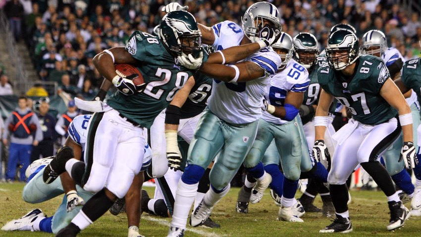 Correll Buckhalter #28 of the Philadelphia Eagles runs the ball against Anthony Spencer #93 of the Dallas Cowboys on December 28, 2008 at Lincoln Financial Field in Philadelphia, Pennsylvania