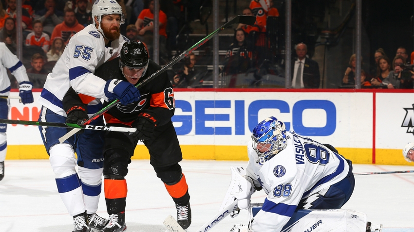 Andrei Vasilevskiy #88 of the Tampa Bay Lightning makes a save in front of Nicolas Aube-Kubel #62 of the Philadelphia Flyers and Braydon Coburn #55 of the Tampa Bay Lightning in the third period at the Wells Fargo Center on January 11, 2020 in Philadelphia, Pennsylvania