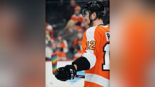 Michael Raffl #12 of the Philadelphia Flyers looks on during warmups prior to his game against the Washington Capitals on January 8, 2020 at the Wells Fargo Center in Philadelphia, Pennsylvania. Raffl's stick is taped in rainbow colors for Pride Night.