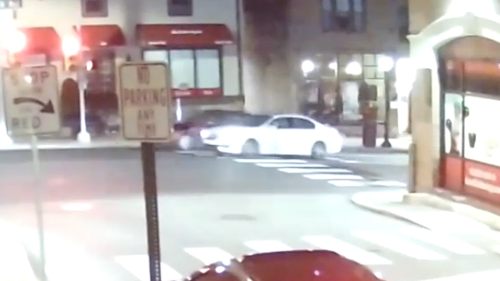 A white sedan crosses an intersection before a fatal hit-and-run crash in Jenkintown, Pennsylvania.