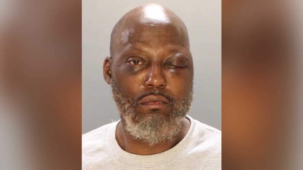 Marvin Scott looks at the camera in a police mug shot. He is suspected of stabbing his ex-girlfriend to death in Southwest Philadelphia.