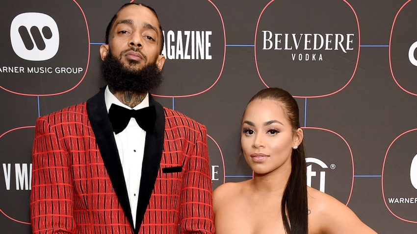 In this file photo, Nipsey Hussle and Lauren London arrive at the Warner Music Group Pre-Grammy Celebration at Nomad Hotel Los Angeles on February 7, 2019 in Los Angeles, California.
