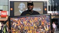 Fighting Back Tears, Fans Continue to Flock to Kobe Bryant Memorial in Los Angeles