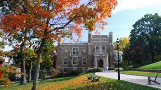 Lehigh University is shown behind trees in autumn.