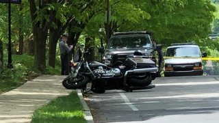 A Pennsylvania State Police motorcycle on its side after a hit-and-run crash in Philadelphia.
