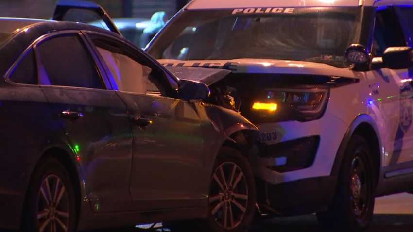 A sedan and a Philadelphia police SUV crash in the city's Kensington neighborhood.