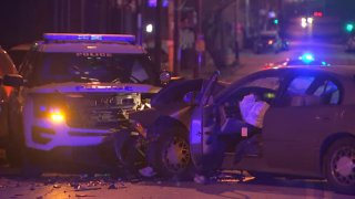 A Philadelphia police SUV and a sedan are totaled after a head-on crash in the city's Logan neighborhood.