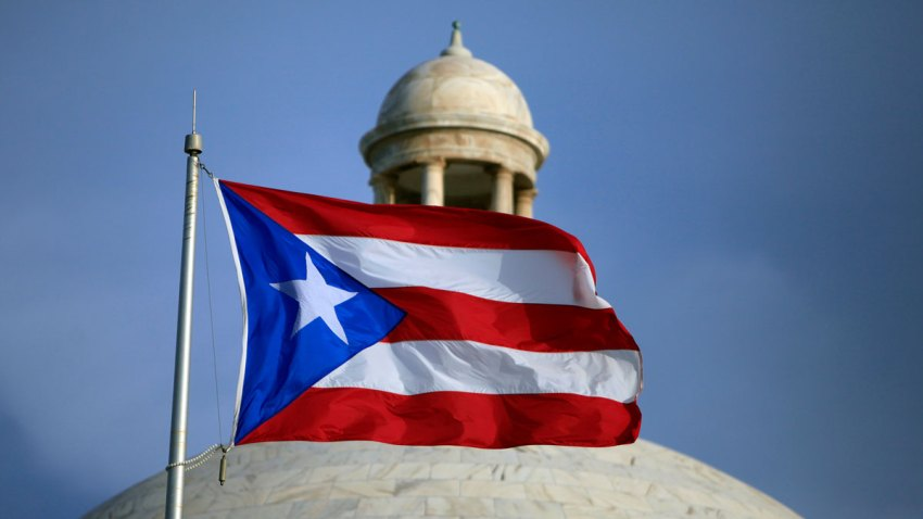 The Puerto Rican flag flies in front of Puerto Rico's Capitol as in San Juan, Puerto Rico.