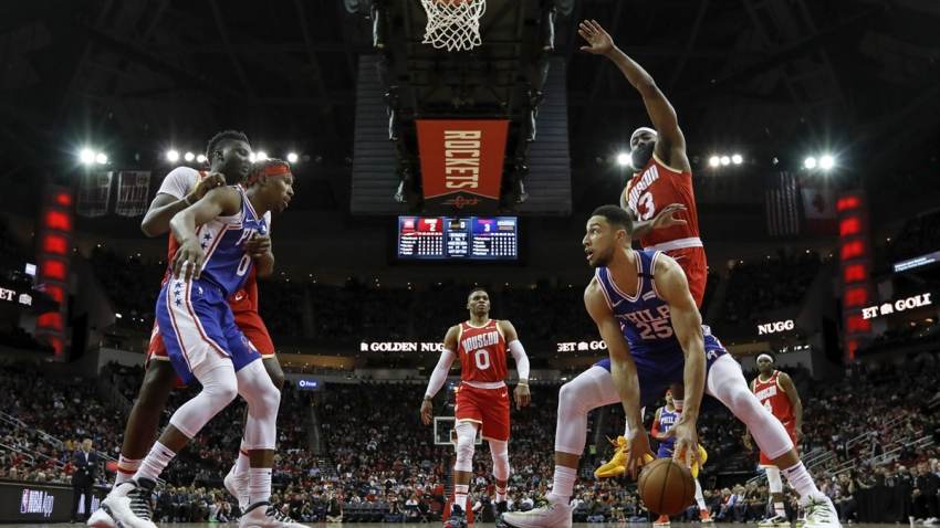 Ben Simmons #25 of the Philadelphia 76ers drives to the basket defended by James Harden #13 of the Houston Rockets