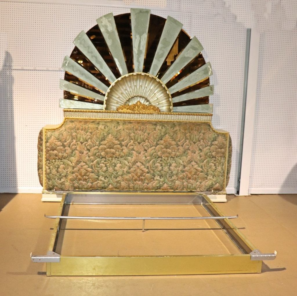 Wood and upholstered base headboard with upper section with Lalique style sunrise motif. Etched glass. Brass bed frame.